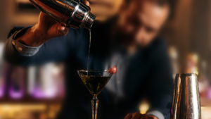 Sytlized image of bartender pouring drink